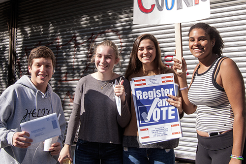 Upper School students canvas the neighborhood for voter registration.