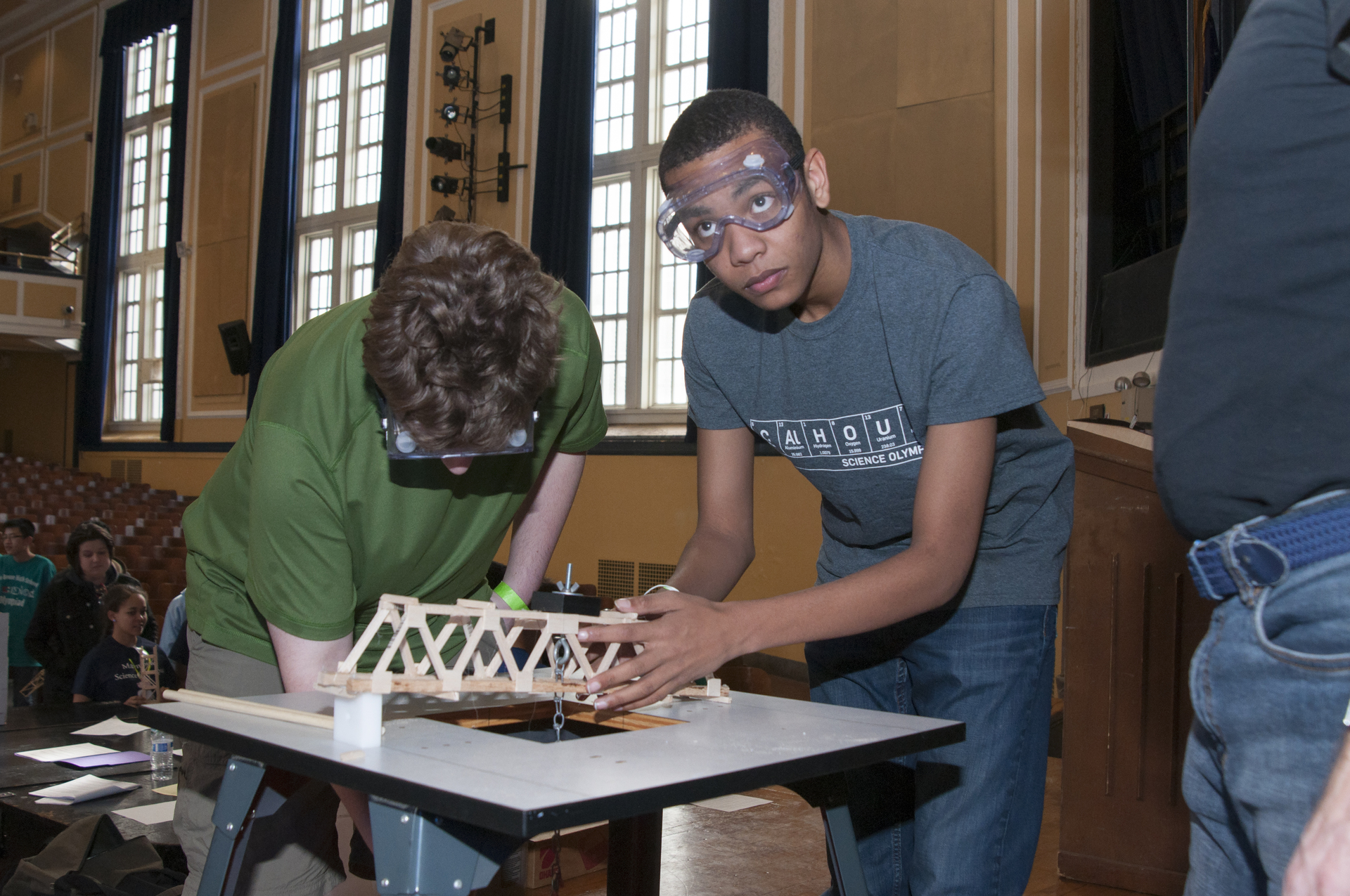 Students competing in the bridge building contest